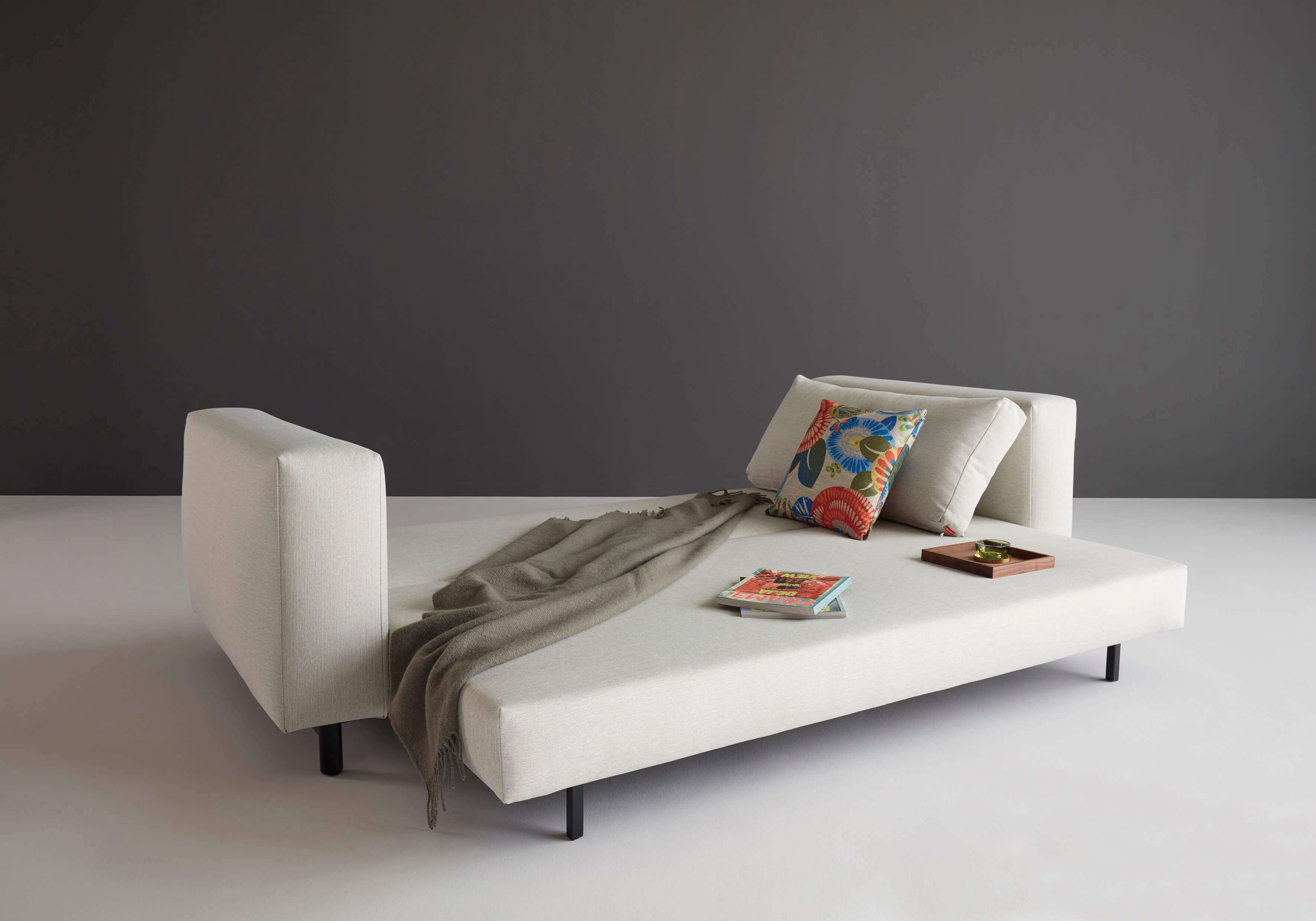 Trendy sofa bed unfolded side view