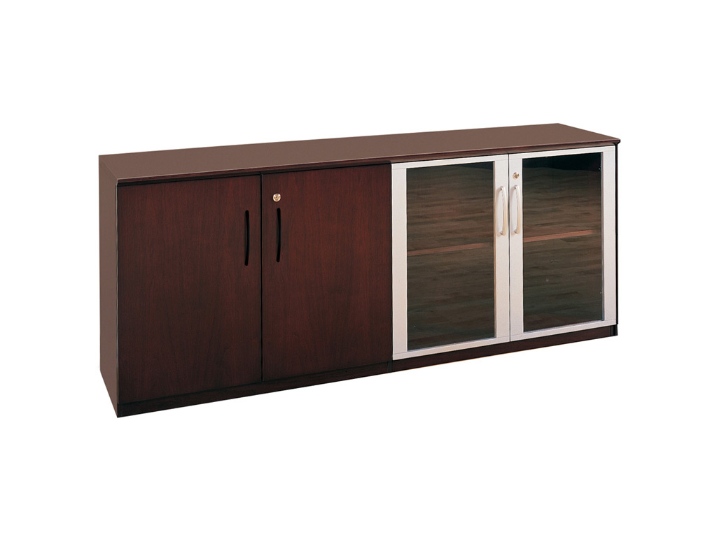 This Wood office desk from Mayline features a low wall cabinet with wood/glass door combination, which includes one adjustable shelf on each side and supports 75 pounds per shelf, evenly distributed. Sets of doors are keyed alike.