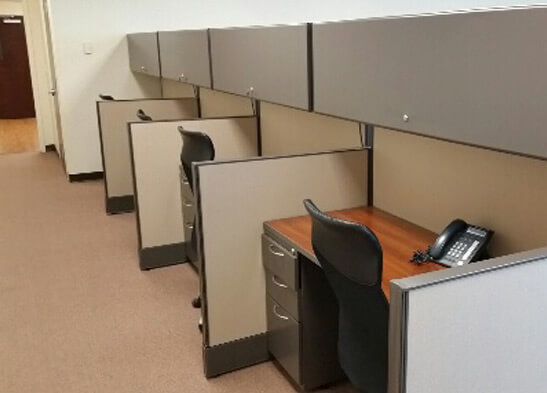 Used cubicles with Low/High Panel Combos from AIS - side view - configured as one cluster of 8 with a center/shared spine wall, and one row of 4