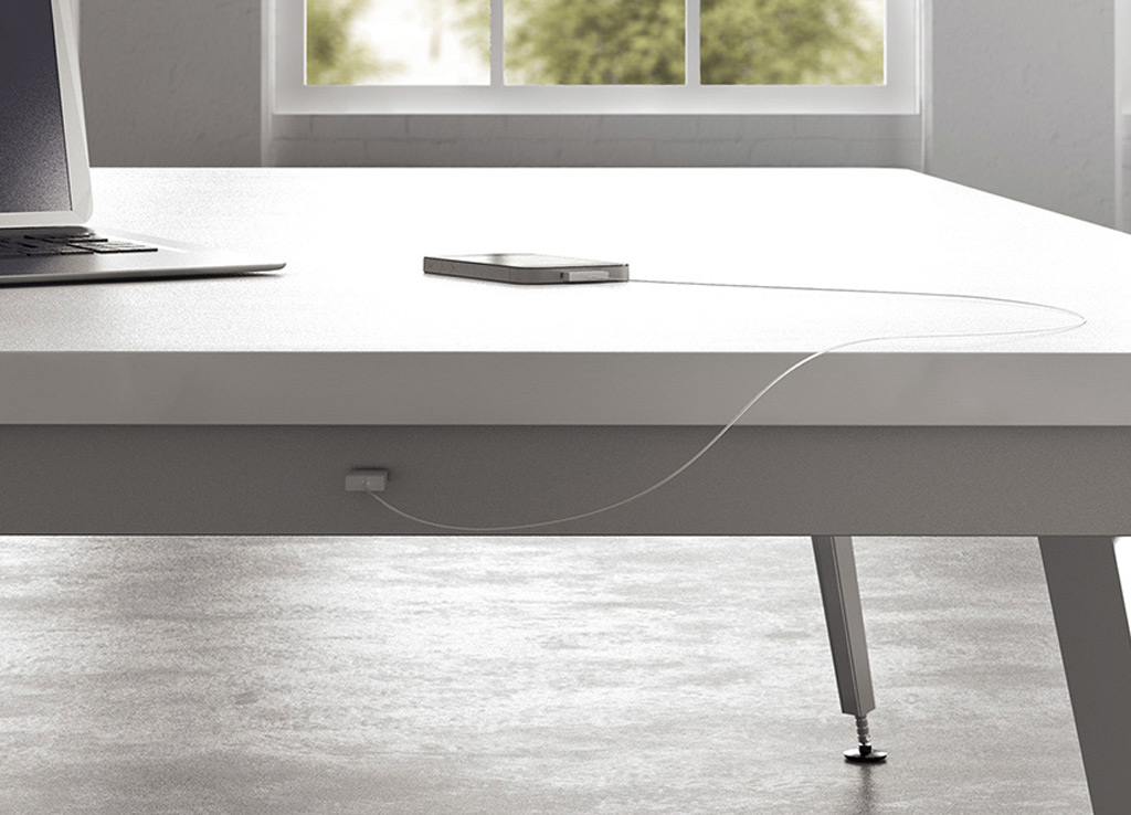 This boardroom furniture from OFS offers easy USB or 120V power access for every seat at the table without interrupting the minimal clean aesthetic of its environment.