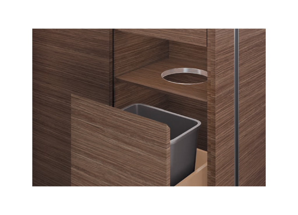 Wood office furniture from OFS provides practical support. The unit features a wastebasket below.