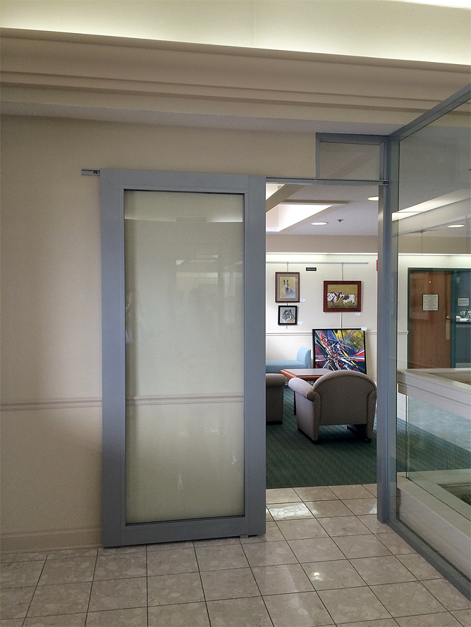 Glass partition walls by for Sliding glass wall price