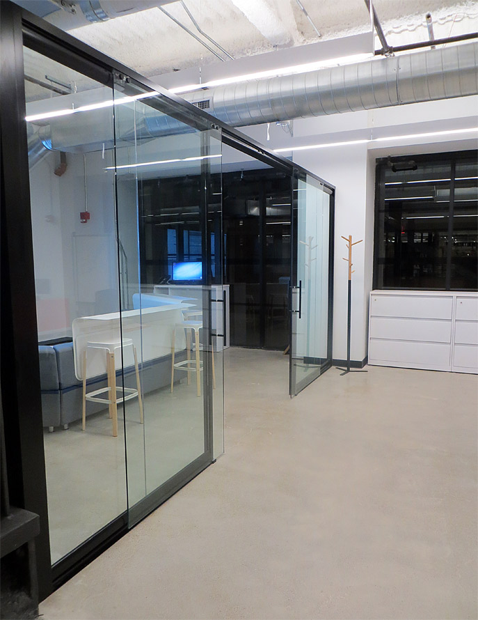 Glass wall office glass wall panels glass partition walls for Sliding glass wall systems